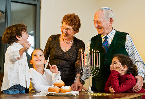 Children and grandparents around the table for Hanukkah 146868418