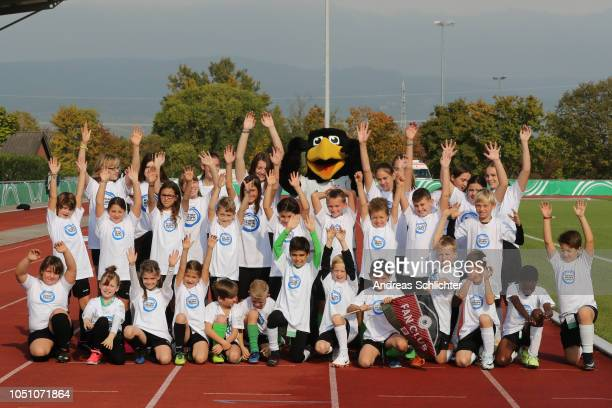 Children and kids of Germany with mascot Paule during the Germany U17 Girl's v Finland U17 Girl's International Friendly match on October 7 2018 in...