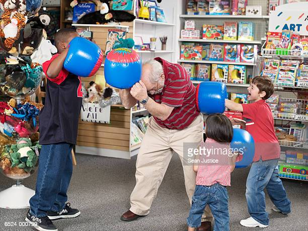 Children and Man in Toy Store