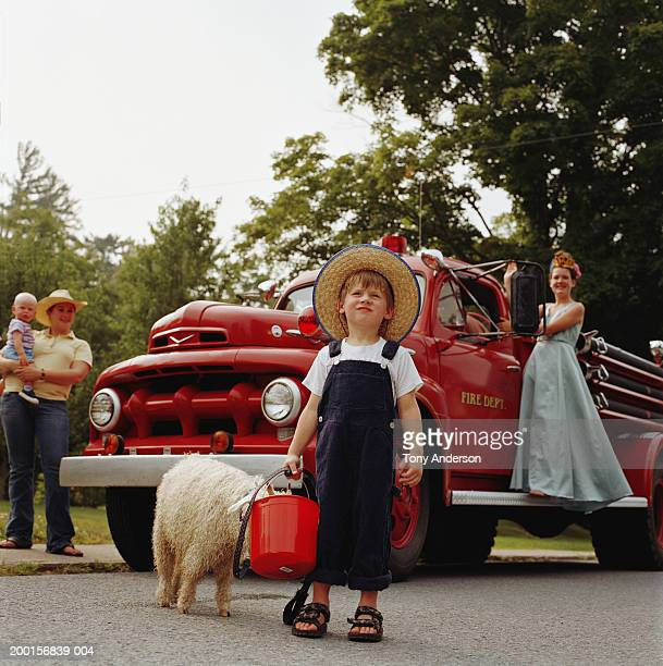 children (3-15) and mother with baby (9-12 months) by fire truck - 12 23 months stock pictures, royalty-free photos & images