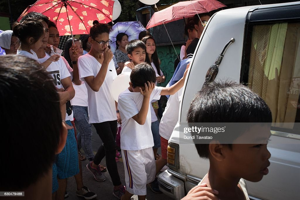 Children and relatives mourn while walking behind a hearse during a funeral held for Alex Hongco on December 12, 2016 in Manila, Philippines. Hongco and three other men were killed when police barged inside a house during an alleged drug session and killed all four men after allegendly shooting it out with raiding police teams. Philippine president Rodrigo Duterte has said he wanted the Constitution amended to allow Philippine leaders to wield martial law powers without judicial and congressional approval, a move he said is necessary to contain the ongoing 'drug menace' and maintain peace and security in the country. Around 5,882 people have been killed across the country since President Rodrigo Duterte launched his war on illegal drugs five months ago, according to figures from the Philippine National Police. An average of 25 victims were killed daily during the five-month period, and police kill 97 percent of those they shoot, leaving 33 dead for every person wounded according to the figures. Last October, Duterte himself said the country could expect about 20,000 or 30,000 more deaths in his administration's bloody war on drugs.