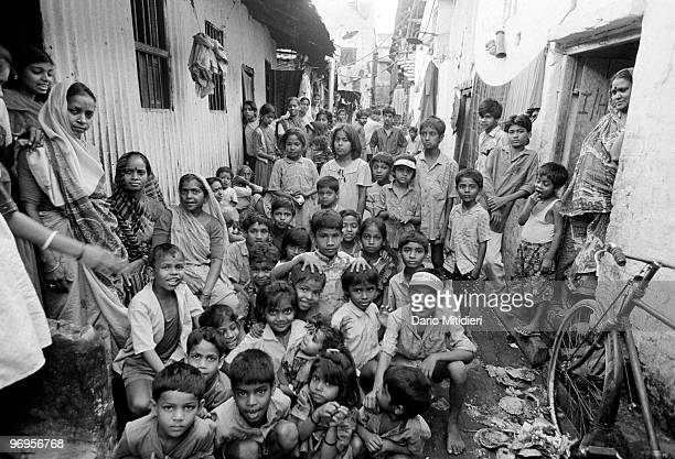 Children and sexworkers photographed in Sonagachi district in Kolkata India 1996 Sonagachi translated as Golden Tree is the largest redlight district...