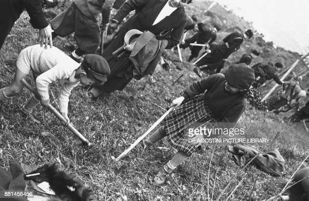 Children and soldiers from the National forestry militia carrying out a reforestation operation April 4 Genoa Italy 20th century
