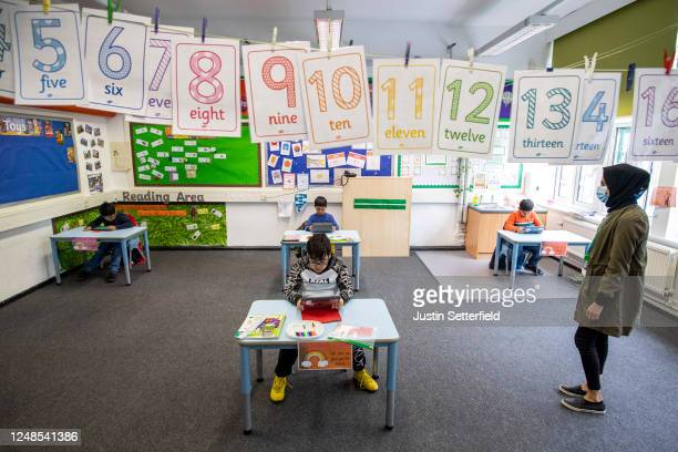 Children and teacher maintain social distancing measures while they take part in lessons at Earlham Primary School on June 09 2020 in London England...