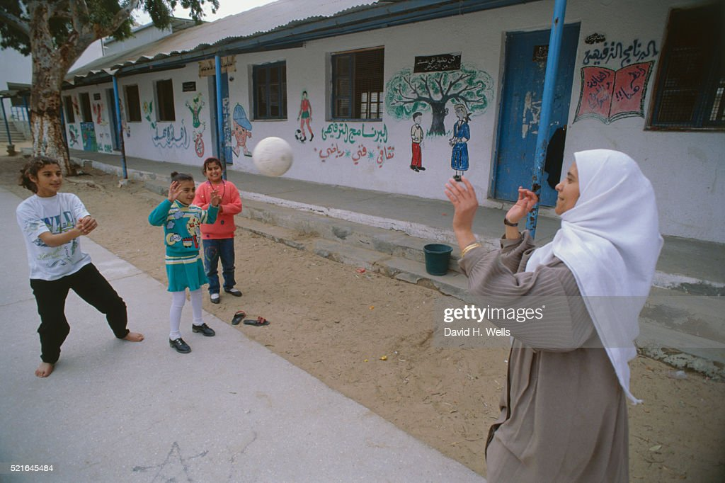 Children and Teacher Playing in Schoolyard : Stock Photo