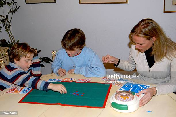 Children and woman playing bingo