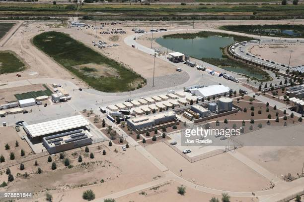 Children and workers are seen at a tent encampment recently built near the Tornillo Port of Entry on June 19 2018 in Tornillo Texas The Trump...