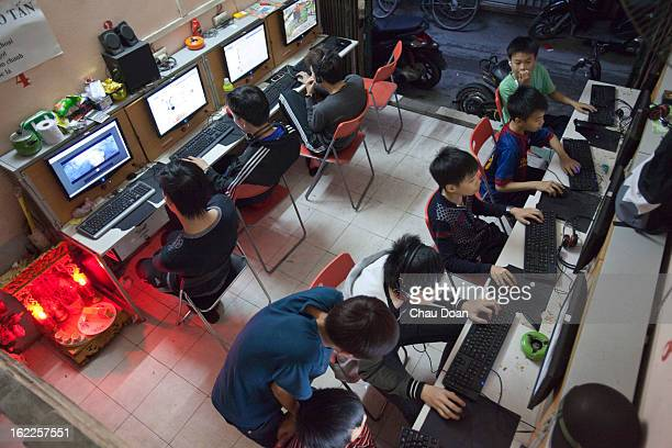 Children and youths play games and watch movies at an internet shop This has become a growing social problem in Vietnam Many families find it hard to...