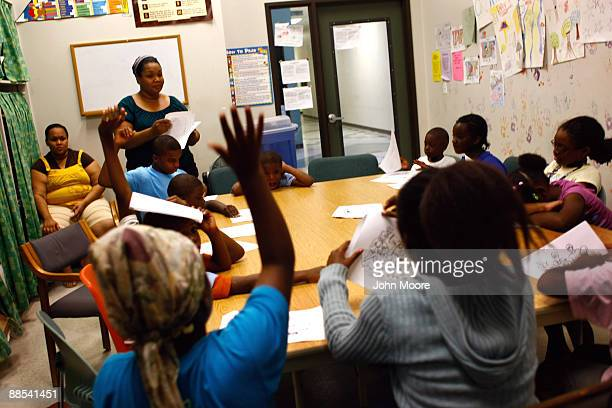Children answer questions during scripture study hour at the Center of Hope shelter for homeless women and children on June 16, 2009 in Dallas,...