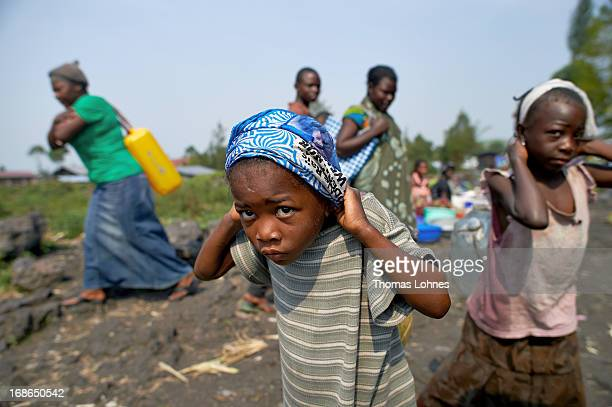 Children are carrying jerrycans in camp Mugunga III for displaced persons on January 14 2013 in Goma Democratic Republic of Congo The war in Congo...