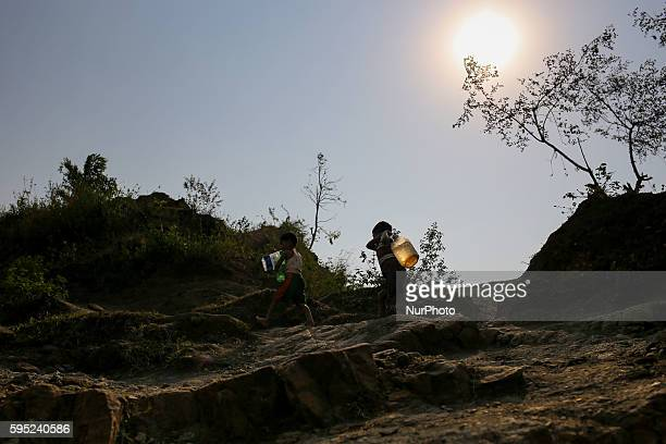 Children are climbing in a hill with dringking water bottle at Jaflong Sylhet Bangladesh on March 18 2016