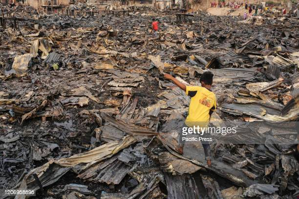 Children are collecting burnt iron sheets and other things from the debris Hundreds of shanties were razed to the ground leaving thousands homeless...