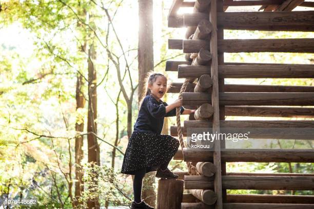 children are enjoying athletic playground equipment. - japanese girls hot stock photos and pictures