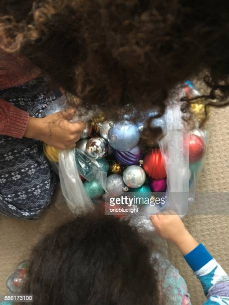 children are getting the christmas decorations out - onebluelight stock pictures, royalty-free photos & images