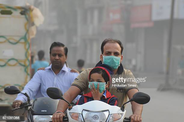 Children are going to school with masks on Smoggy morning on November 4 2016 in Gurgaon India Four biggest school of Gurgaon declared the holiday due...