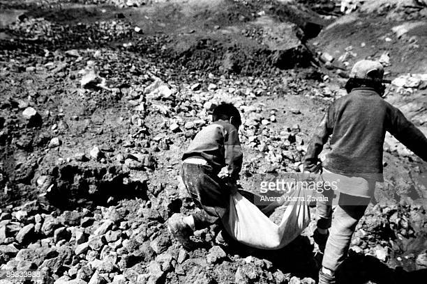 Children are often illegally employed to work in mines in Bolivia Pictured here are two boys working at the washing place where the children miners...