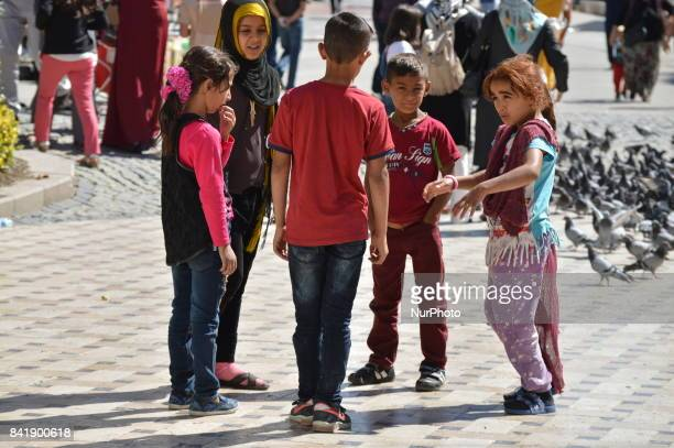 Children are pictured as people enjoy their holiday by visiting the Haci Bayrami Veli Mosque and its around on the second day of Muslims' sacrificial...