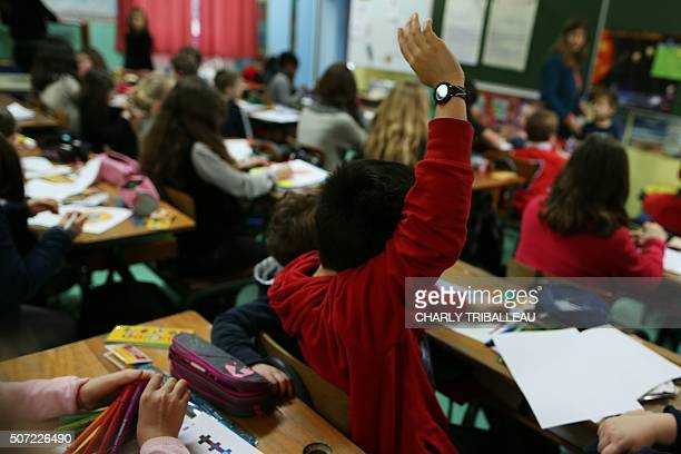 Children are pictured as they attend a lesson in a classroom of a primary school in CherbourgOcteville northwestern France on January 28 2016 / AFP /...