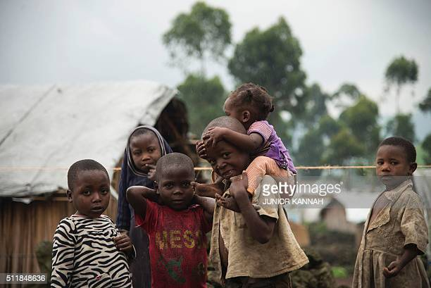 Children are pictured at the Mungote Internally Displaced Persons camp in Kitchanga 80 kilometres from Goma on February 23 2016 UN chief Ban Kimoon...