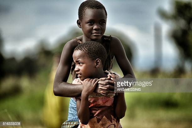 Children are pictured in the outskirts of Lilongwe on March 11 2016 / AFP / ARIS MESSINIS / RESTRICTED TO EDITORIAL USE