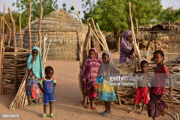 Children are pictured in the village of Azel near Agadez northern Niger on April 6 2017 The region has been recently hit by severe drought / AFP...