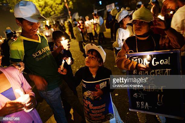 Children are pictured with candles during a protest against child slavery attended by Indian Nobel laureate Kailash Satyarthi in New Delhi on...
