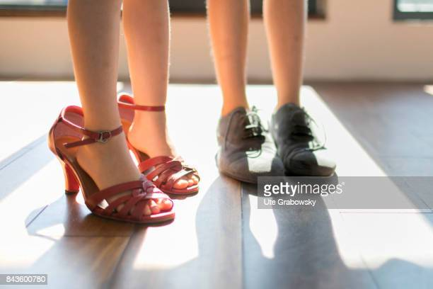 Children are playing and wear too big shoes of their parents on August 07 2017 in Bonn Germany