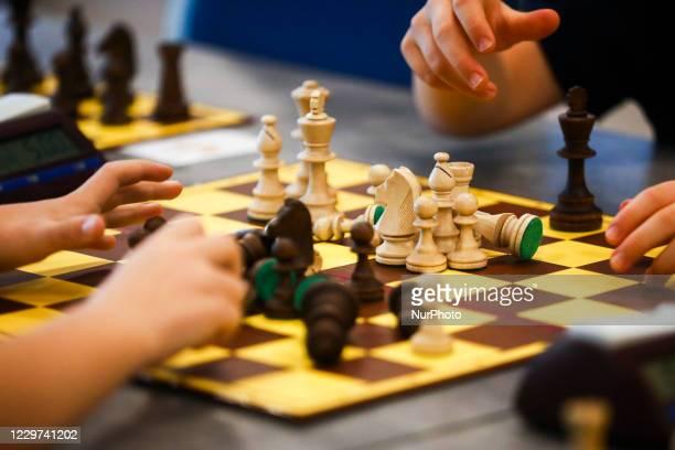 Children are playing chess during coronavirus pandemic at Junior Speed Chess Championship in Krakow, Poland on November 21, 2020.