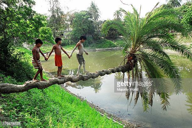 Children are playing in a village in Aricha Bangladesh March 30 2007
