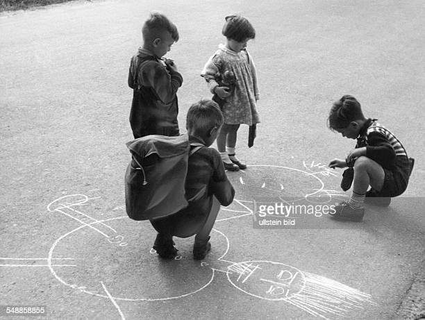 children are playing on the street 1950s