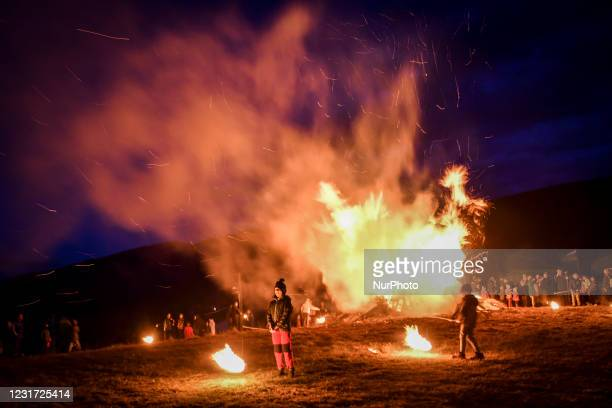 Children are playing with fireballs near a bonfire during the celebration of 'Sirni Zagovezni', a popular Orthodox Christian holiday which takes...