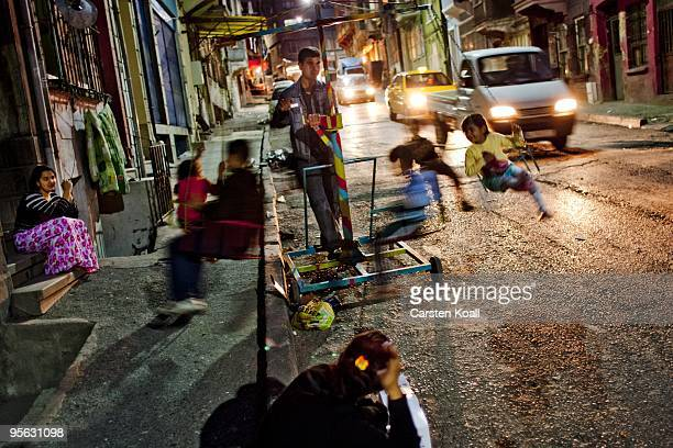 Children are riding a mobile carrousel in the street in the district Tarlabasi on May 16, 2006 in Istanbul, Turkey. Tarlabasõ is a neighbourhood in...