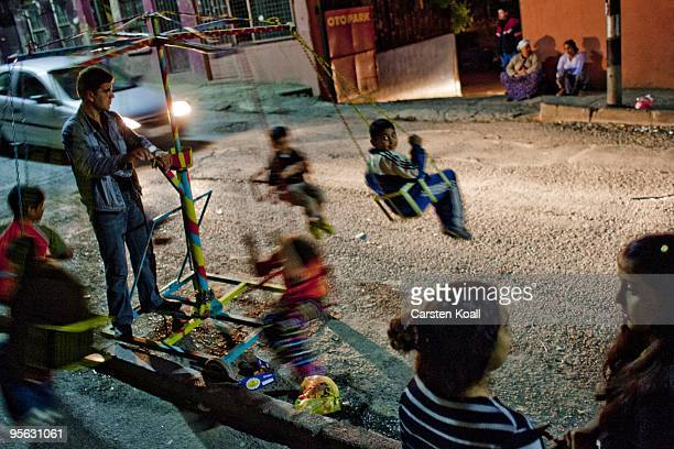 Children are riding amobile carrousel in the street in the district Tarlabasi on May 16, 2006 in Istanbul, Turkey. Tarlabasõ is a neighbourhood in...