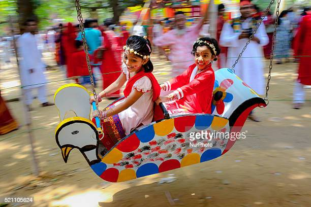 Children are riding on Nagordola a traditional amusement ride to celebrate their first day of bengali new year in Dhaka Bangladesh on April 14 2016