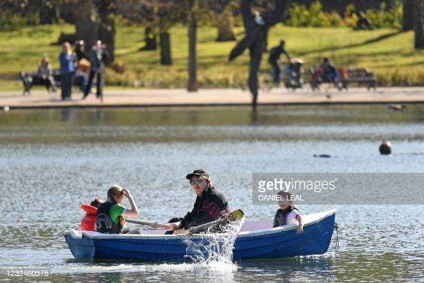 Children are rowed across the lake in the Spring sunshine in Victoria Park, east London on April 22, 2021. - Under the relaxing of the Covid-19...