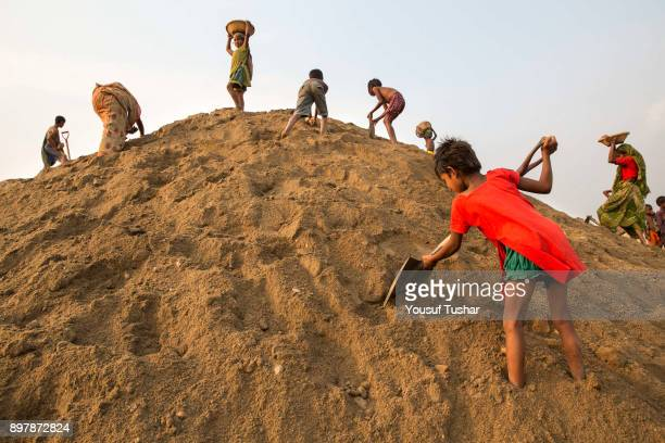 Children are searching for stones at Jaflong Stone Quarry field The crystal clear water of the Piyain River which flows from India through Bangladesh...