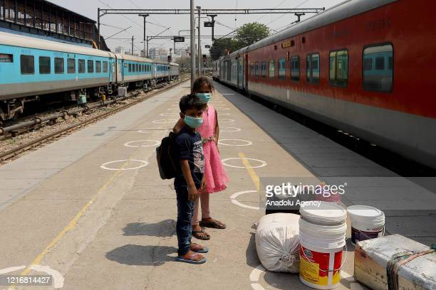 Children are seen as they wait to board a train at New Delhi Railway Station, during the COVID-19 lockdown 5.0 measures, in New Delhi, India on June...