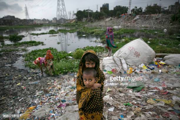 Children are seen at a plastic factory on the banks of a canal which empties into the Buriganga river on June 3 2018 in Dhaka Bangladesh Bangladesh...