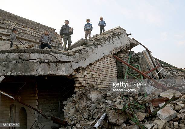 Children are seen at Mosque of the Prophet Yunus after it has been rescued from Daesh by Iraqi Army in Mosul, Iraq on January 23, 2017. Daesh...