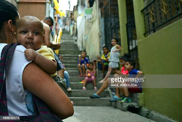 Children are seen at the Pablo Escobar neighborhood in Medellin, Colombia, on December 2, 2015. 22 years after his death, Escobar is still revered by...