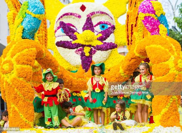 Children are seen atop a float decorated with flowers during the battle of the flowers parade on August 29 2014 in Laredo Spain