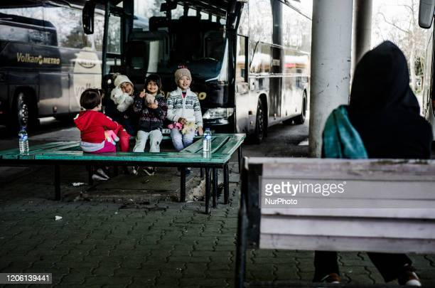 Children are seen hide their faces and joking at the bus station of Edirne, Turkey. Many children suffer because of the migrants crisis along...