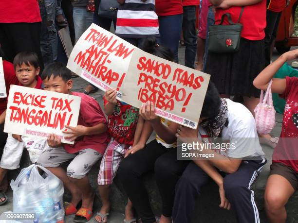 MENDIOLA MANILA PHILIPPINES Children are seen holding placards during the protest Leftist groups stage Bonifacio Day of protest in Mendiola and at...