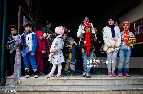 Children are seen in the refugee camp in Lavrio Greece on February 9 2019 A woman from northern Greece made scarfs and beanies for the children from...