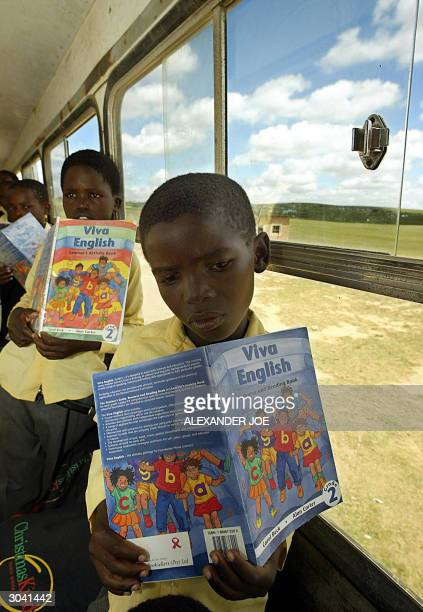 Children are seen in their Vukani senior primary school classroom set in an old school bus 27 February 2004 in Qunu located about 35 kilometers south...