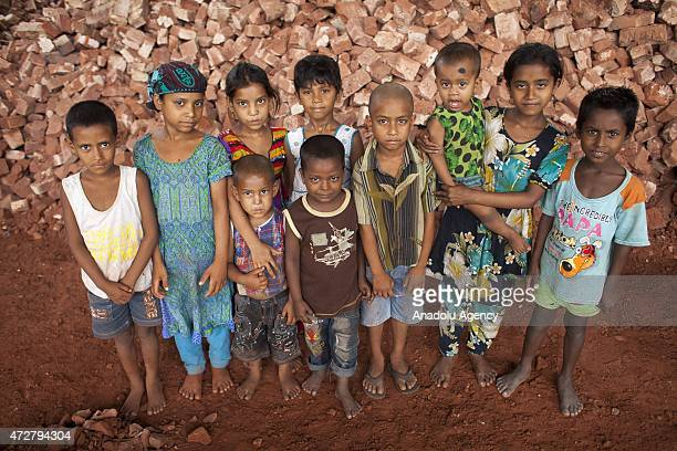 Children are seen near their mother's work place in Dhaka Bangladesh on May 9 2015 Bangladeshs working mothers from poor background face difficulties...