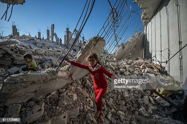 Children are seen on the rubble of a building in the Jarabulus district of Aleppo Syria on October 1 2016 Families who returned to their homes back...