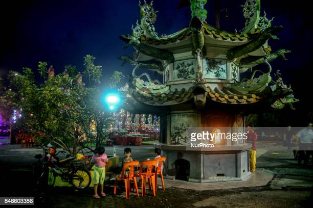 Children are seen play inside the chinese temple during the Hungry Ghost Festival in Teluk Pulai Klang, Malaysia on September 13, 2017. Photo by...