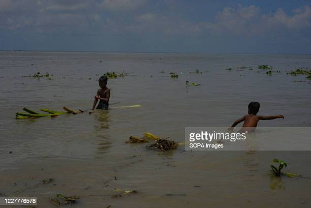 Children are seen playing in a flooded area. The flood situation is worsening in Munshiganj. Due to the heavy rain, the water level of the Padma...