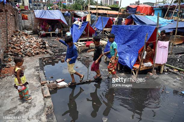Children are seen playing in Sat tala slum where several hundreds of houses were gutted as the devastating fire broke out a few days ago. According...